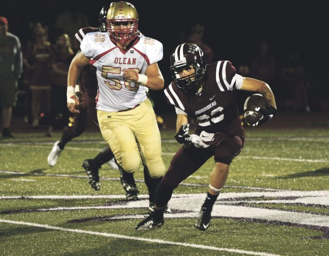 ZOBSERVER Photo by Justin Goetz Dunkirk's Issiah Velez evades Olean's Zach Parr on a running play during the Marauders' 28-0 shutout of the visiting Huskies Friday night.