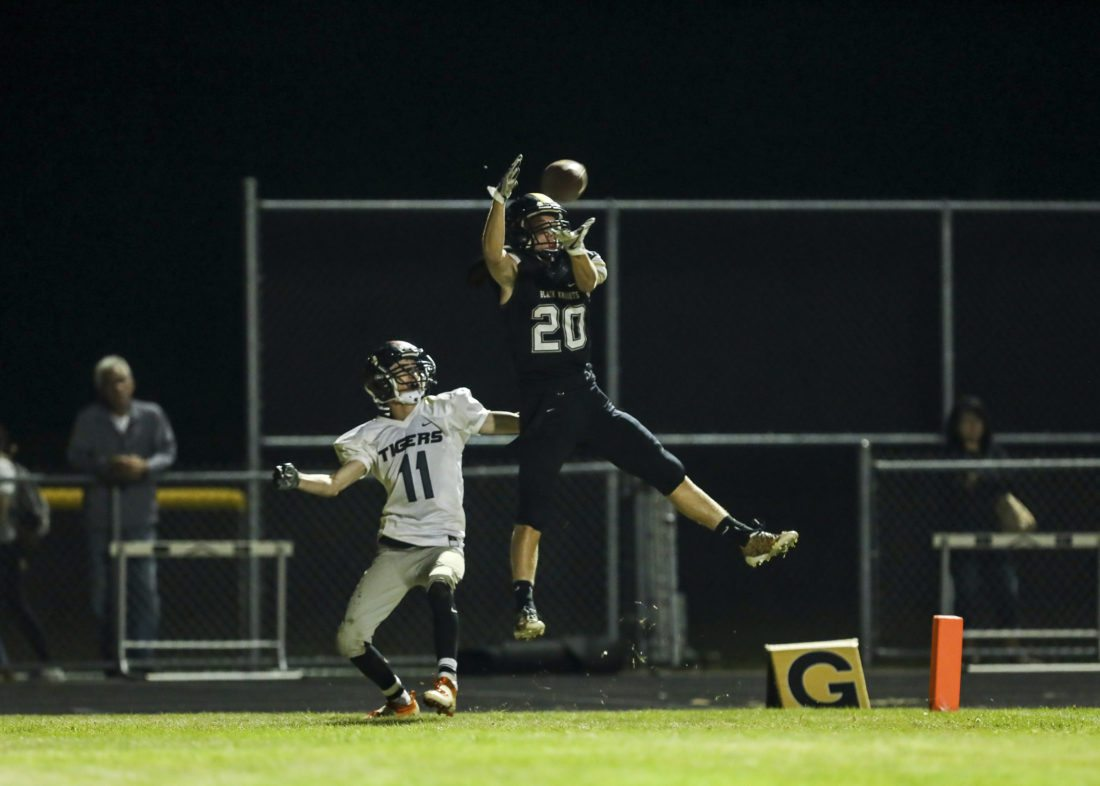 OBSERVER Photo by Joe Conti Silver Creek-Forestville's Dylan Weber jumps in front of Akron's Derek Holtz to make an interception that sealed the Black Knights' 13-6 win Friday night.