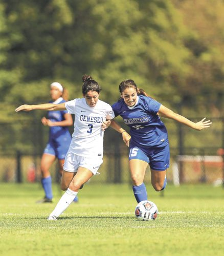 OBSERVER Photo by Joe Conti Geneseo's Jamie Forken (3) and Fredonia's Danielle Spring (15) fight for possession in Saturday afternoon's women's soccer game in Fredonia.