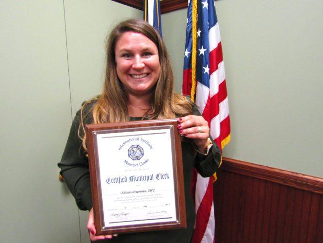 OBSERVER Photo by Greg Fox Pomfret Town Clerk Allison Dispense proudly shows off her award declaring her a certified municipal clerk.