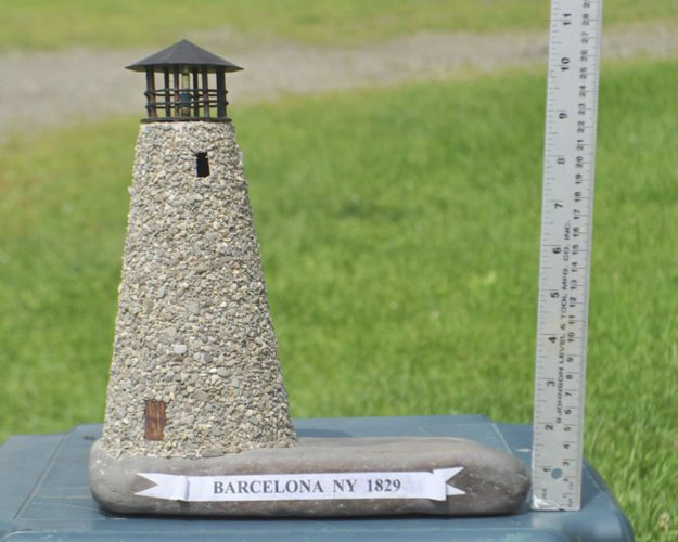 Submitted Photo: Pictured at left is the 1/500th replica of the Barcelona Lighthouse for sale at Monroe Marine's.