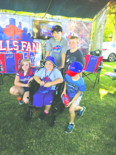 Submitted photo: Garrett Engle, middle in front, poses with family and friends before entering New Era Field on Sunday.