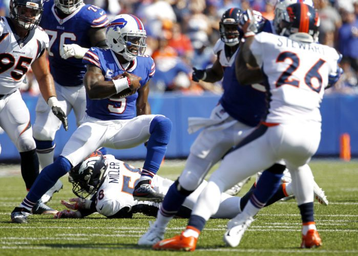 Buffalo Bills quarterback Tyrod Taylor (5) avoids a tackle by Denver Broncos outside linebacker Von Miller (58) during the first half of an NFL football game, Sunday, Sept. 24, 2017, in Orchard Park, N.Y. (AP Photo/Jeffrey T. Barnes)