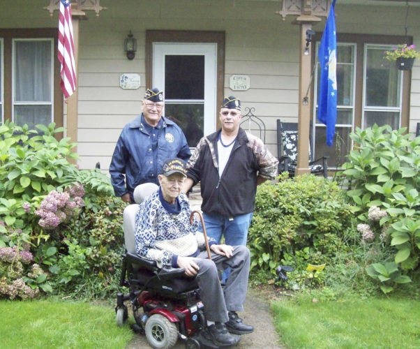 Submitted photo: Richard Makuch, commander of the Charles Tinley Memorial Chapter 142 of the Disabled Veterans of America, left, and Ken DeLong, right, post adjutant, present Forestville veteran Norbert Smith with an electric wheelchair that was donated through the organization's program of Vets Helping Vets. Smith served with the U.S. Air Force and was a bomber during the Korea and Vietnam wars. Makuch said Smith is one of many vets who have fallen through the crack and are not able to receive items such as the wheelchair to get around.