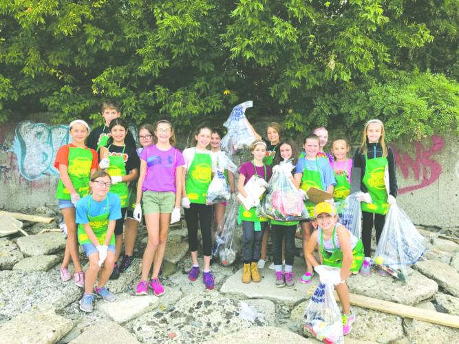 Submitted Photo: Fredonia Middle school service Learning Club picks up trash at Wright Park Beach on Saturday, Sept. 16.