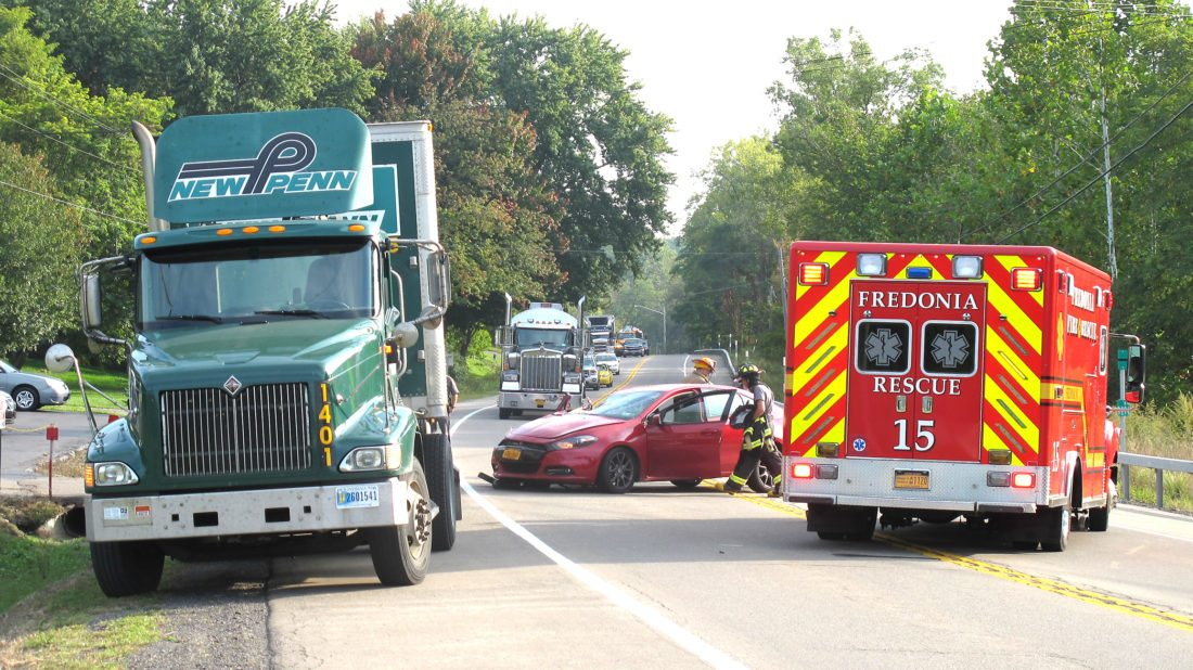 OBSERVERPhoto by Damian Sebouhian A vehicle traveling north on Route 60 at around 4:30 p.m. crashed into the rear of a north-facing tractor trailer that was parked on the shoulder in front of Miceli's Auto Sales. State Police, Fredonia Fire Department and Alstar responded to the scene. Although there was no official report of injuries at the time, witnesses say they saw a woman and her baby taken by Alstar to Brooks Hospital.  Fredonia Fire Chief Kurt Maytum verified that the driver, a woman, was taken to Brooks Hospital.