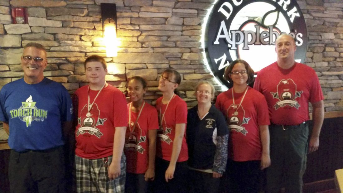 Submitted Photo: Members of the Dunkirk Lakers Special Olympics team and officers from Lakeview Shock Correctional Facility, participated in the NYS Law Enforcement Torch Run fundraiser for Special Olympics on Sept. 14, at Applebee's Restaurant in Dunkirk. Applebee's has supported Special Olympics with this fundraiser for many years.