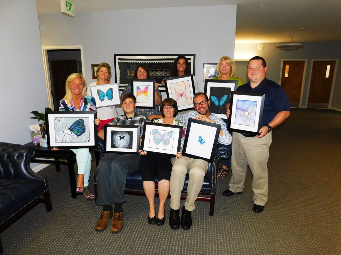Chautauqua Hospice and Palliative Care Staff is pictured with some of the Student Artwork that will be featured at the charity auction Friday at Chautauqua Suites in Mayville