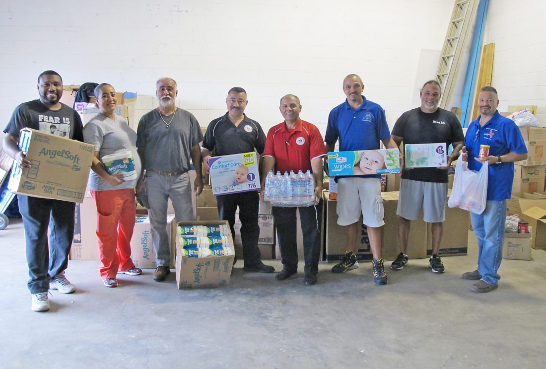 Jamestown residents collected two truckfuls of water, baby items, toiletries and food and dropped off the items Thursday at the city of Dunkirk's drop-off point. Pictured from left are Freddie Holmes, Vidalys Colon, Vidal Colon, Dunkirk Mayor Willie Rosas, Dunkirk City Clerk Edwin Ramos, Billy Torres, Edwin Ortiz and Robert Rosas.