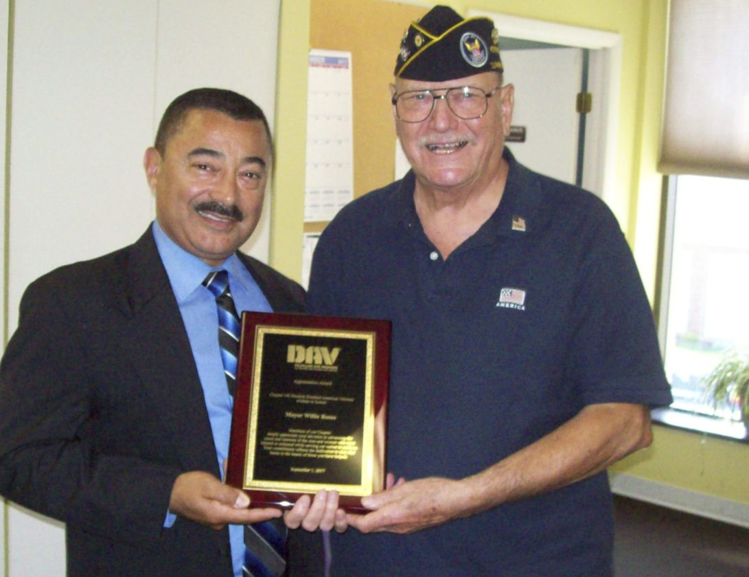 Submitted Photo: Richard Makuch, right, presents Dunkirk Mayor Wilfred Rosas with a plaque for the city's loyal support to the Charles Tinley Memorial Chapter 142 of the Disabled American Veterans. Without the support of local business and the community, the organization could not continue to provide assistance to veterans in the area who truly need it. The organization would also like to thank family, friends, the Dunkirk Veterans Administration Clinic and the Dunkirk Jr. ROTC for all their support.