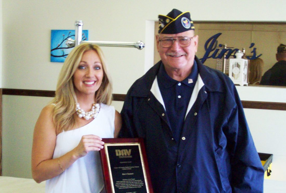 Submitted Photo Richard Makuch, right, presents Beth Zappie of Jim's Cleaners with a plaque for their loyal support to the Charles Tinley Memorial Chapter 142 of the Disabled American Veterans. Without the support of local business and the community, the organization could not continue to provide assistance to veterans in the area who truly need it. The organization would also like to thank family, friends and the Dunkirk Jr. ROTC for all their support.