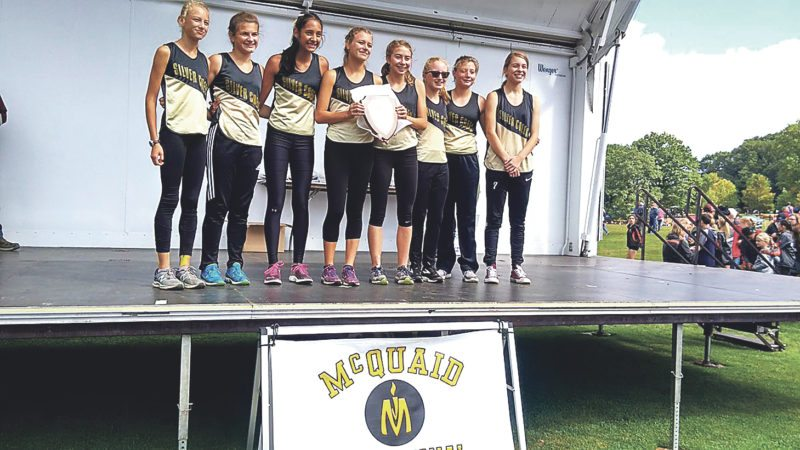 Silver Creek girls cross country team poses at the awards ceremony after its first-place overall finish in race No. 2 of the McQuaid Invitational.