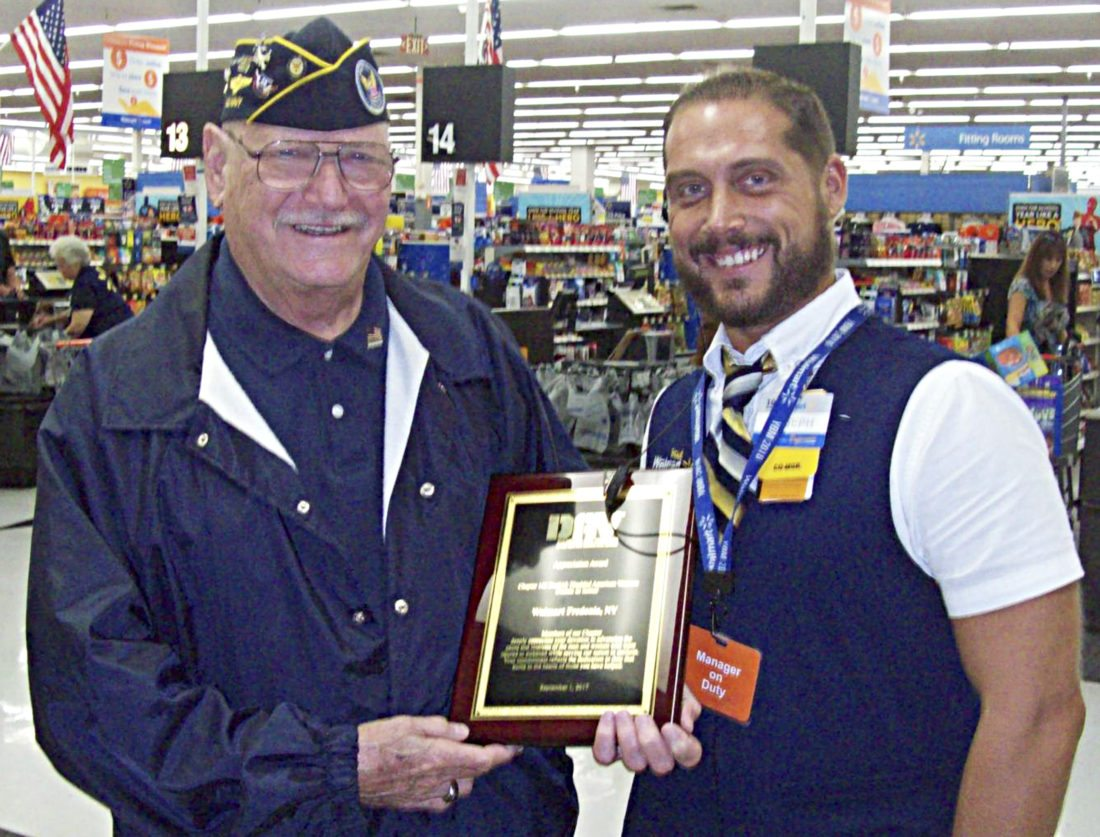 Submitted Photo Richard Makuch, left, presents Joseph Grabka of Walmart with a plaque for their loyal support to the Charles Tinley Memorial Chapter 142 of the Disabled American Veterans. Without the support of local business and the community, the organization could not continue to provide assistance to veterans in the area who truly need it. The organization would also like to thank family, friends, the Dunkirk Veterans Administration Clinic and the Dunkirk Jr. ROTC for all their support.