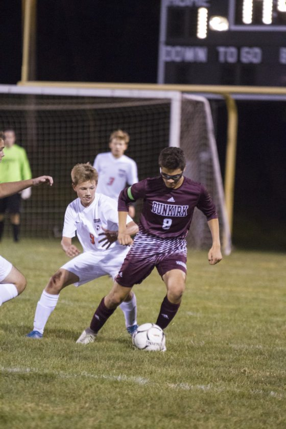 OBSERVER Photo by Mary Ann Wiberg Dunkirk's Josue Alfaro plays the ball, with Fredonia's Michael Persch (9) close behind, during Monday's boys soccer match at the Orange Bowl in downtown Fredonia.