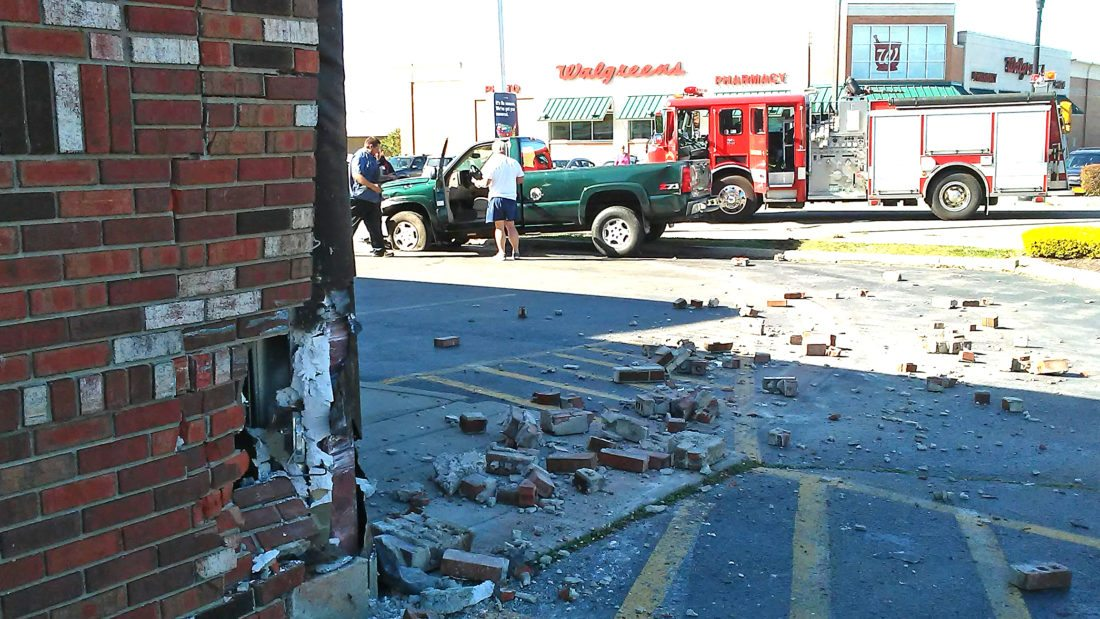 OBSERVER Photo by Damian Sebouhian Pictured is the scene at CVS parking lot after a man in a pickup reportedly suffered a medical condition causing his truck to strike a vehicle and careen into a light pole after swiping the side of the CVS building.