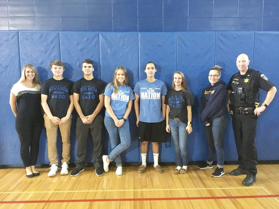 OBSERVER Photo by Andrew David Kuczkowski From left, SADD Club Advisor Shannon Styles, Zach Carroll, Jacob Hostetter, Abbey Phillips, Prince Seneca, Sydney Blocher, Kylie Russell, Deputy Ben Shields. The group was an integral part in bringing the National Save A Life Program to Gowanda Tuesday morning.