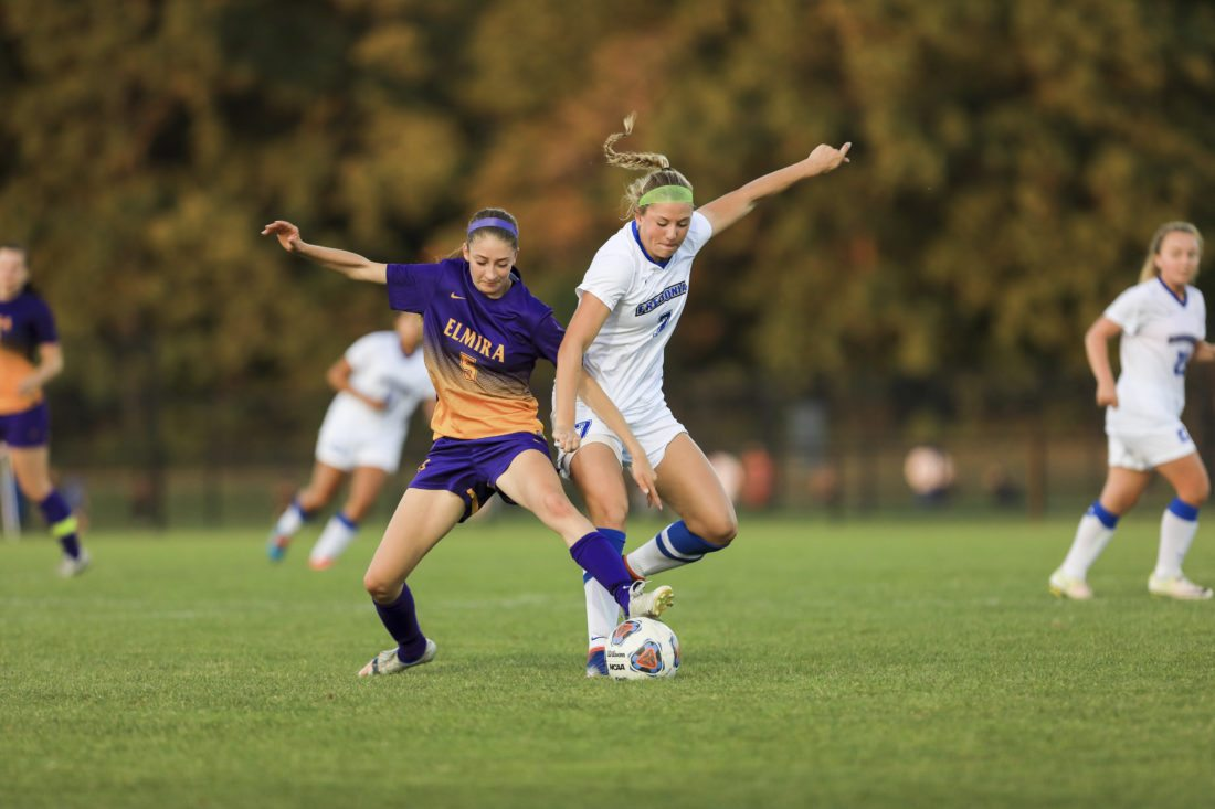 OBSERVER Photo by Joe Conti Lauren Cullinan of SUNY Fredonia battles with Taylor Hanson of Elmira during Tuesday's match in Fredonia.