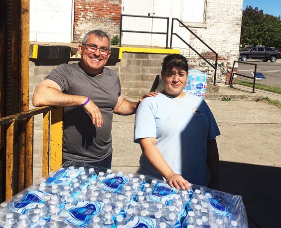 OBSERVER Photo Max Martin of the Hispanic Community Council, left, and Jeanette Delgado round up collected supplies for Puerto Rico on Tuesday.