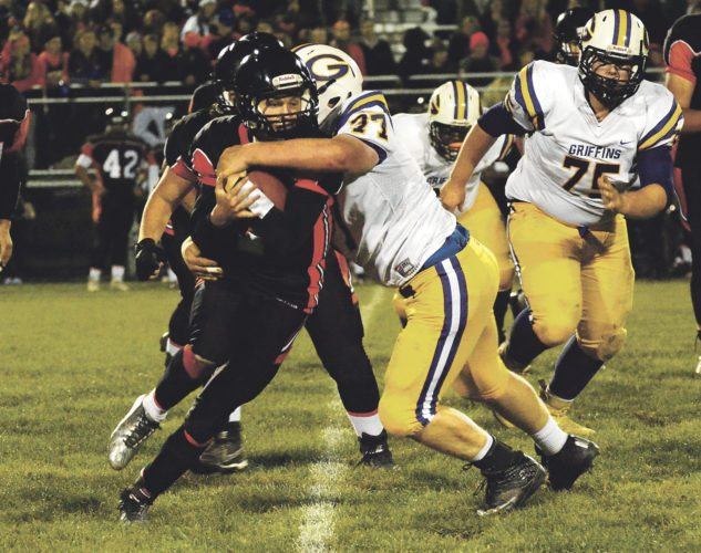 OBSERVER File Photo Fredonia-Westfield-Brocton's Reid Tarnowski is wrapped up by a Springville player during Friday's game. The Badgers travel to Akron today to take on the Tigers, a team that, like F-W-B, has a 2-3 record on the season.