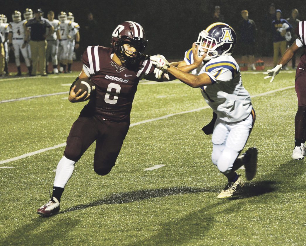 OBSERVER Photo by Justin Goetz Dunkirk's Jaziah Rivera stiff-arms Albion defender Brilliance Johnson during the Marauders' 18-15 victory Friday night at Karl Hoeppner Field.