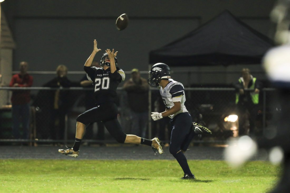 OBSERVER Photo by Joe Conti Silver Creek-Forestville's Dylan Weber (20) stretches for a catch as Cattaraugus-Little Valley's Quentin Martinez trails during Friday's game.