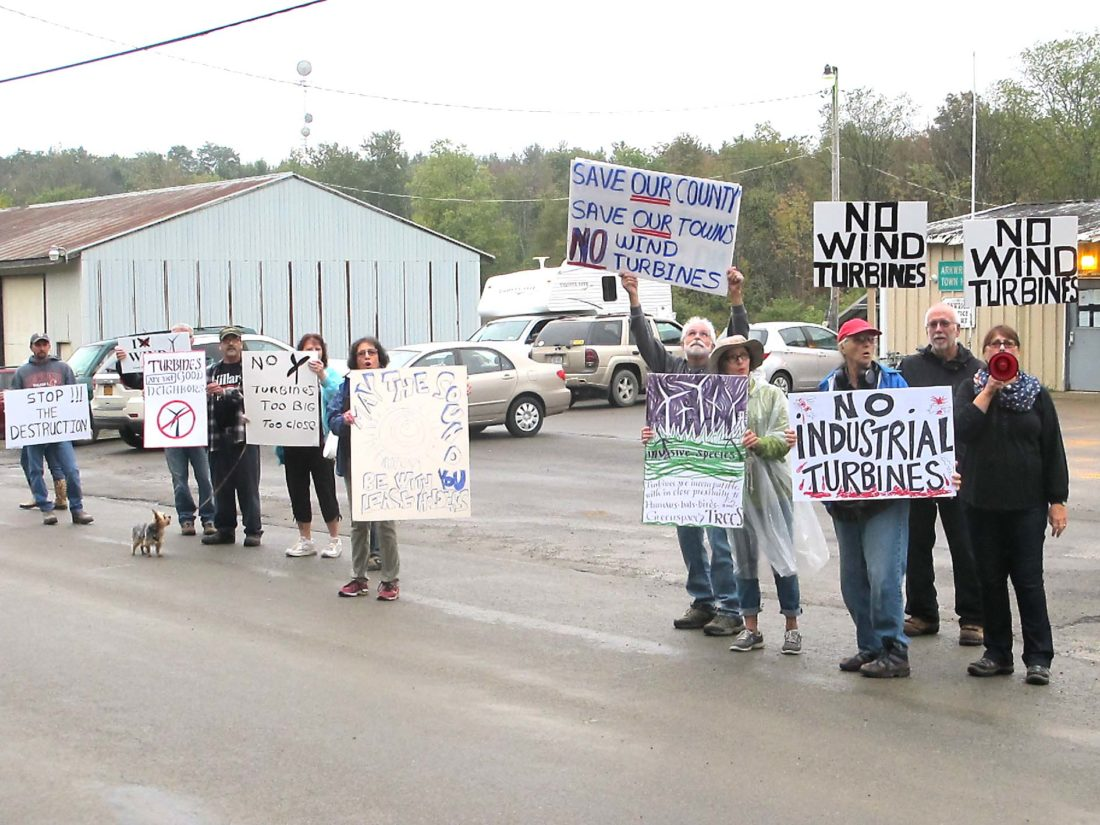 Protesters gather outside of the Arkwright Town Hall Friday to show their opposition to the wind farm project.