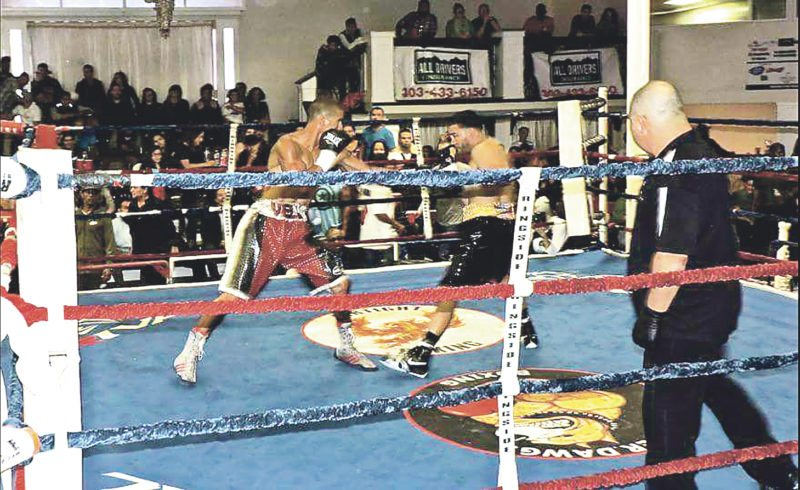Submitted Photo Seville Hasan (left, red trunks) throws a jab against Dunkirk native Tommy Roque (black trunks) in Roque's professional boxing debut at Ready2Rumble Sept. 29, in Westminster, Colorado.