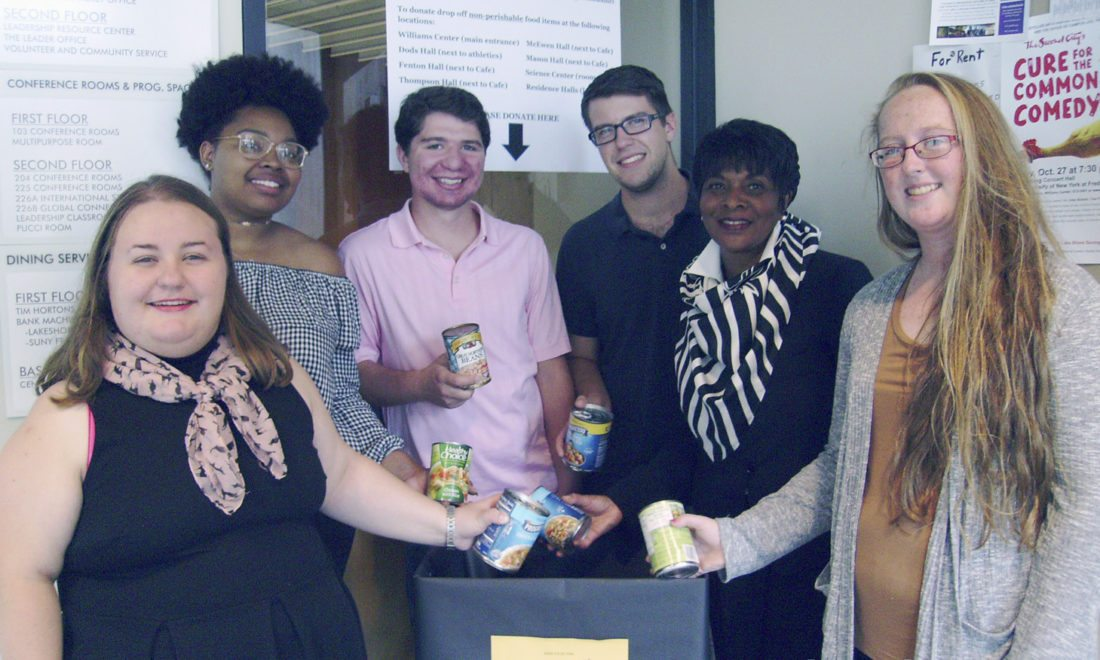 Submitted Photo: Molly Mellott (Volunteer and Community Services Intern), Shantasia Johnson (Sister Circle), Justin Gennaro (Alpha Phi Omega), Jacob Patterson (Kappa Sigma), Joyce Smith (Coordinator of Volunteer and Community Services) and Heather Sullivan (Alpha Phi Omega) make preparations on the SUNY Fredonia Campus for the Feeding Fredonia Challenge, which benefits the Fredonia Food Pantry. The Challenge will be held all over the Village of Fredonia from Oct. 16 through Oct. 20.
