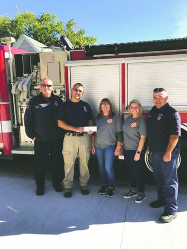 Submitted Photo: Local 616 members along with Muscular Dystrophy Association has announced a total of $5,000 has been collected in this year's MDA Fill the Boot Drive, held Sept. 1. A check presentation was held Oct. 2. The Dunkirk Fire Department would like to thank the many members and visitors of the community for their gracious donations that made this year's collection another great success. Dunkirk Fire Department Local 616 has partnered with MDA since 1954. This year's drive was in honor of Officer Matt Hazelton. Pictured from left are Lt. Anthony Thomas; Firefighter Devin Freitas, MDA Chairman; Heather Powers, MDA fundraising coordinator; Alicia Sinicropi, MDA fundraising coordinator; and James Muscato, DFD Local 616 president.
