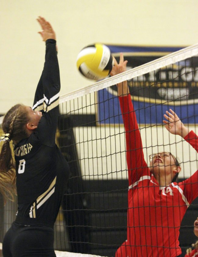 Tuesday saw a full schedule of high school girls volleyball in the CCAA North division. Left, Maranda Perez (14) of Cassadaga Valley tries to tip around the block put up by Krystel Schwab (8) of Silver Creek. Right, Dunkirk's Aaliyah Bass (9) gets into a battle at the net with Brocton-Westfield's Jypsi Eidens (10) and Hannah Hoebner.