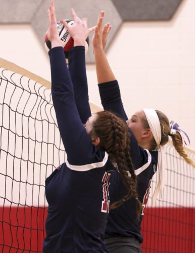 OBSERVER Photo by Lisa Monacelli Josie Simora (left) and Olivia Anderson of Chautauqua Lake make a block at the net during Wednesday's match.