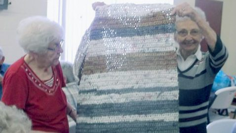 Submitted Photo Pictured are Mt. Carmel Seniors Carolyn Dorothy (left) and Ruth Dolce examining one of the mats the Mt. Carmel Senior Club members have made.