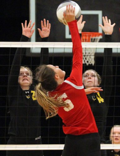 OBSERVER Photo by Lisa Monacelli Katrina Bretl (5) of Cassadaga Valley tries to hit through a block put up by Caroline Kaicher (2) and Alison Mierzwa (14) of Forestville during Thursday's volleyball match.