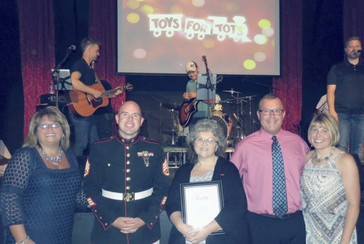 Submitted Photo Pictured are Heather C. Brown, Toys for Tots drive organizer; Marine Staff Sgt. Christopher Bruns; Evelyn Wright-Kegelmyer, Toys for Tots Volunteer of the Year; and Toys for Tots drive organizers Patrick Smeraldo and Terri Johnson.
