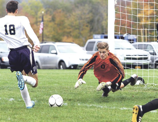 OBSERVER Photo by Lisa Monacelli Silver Creek-Forestville goalie Jeremey Wilcox dives to make a save on a shot from Falconer-Cassadaga Valley's Ben Anderson (18).