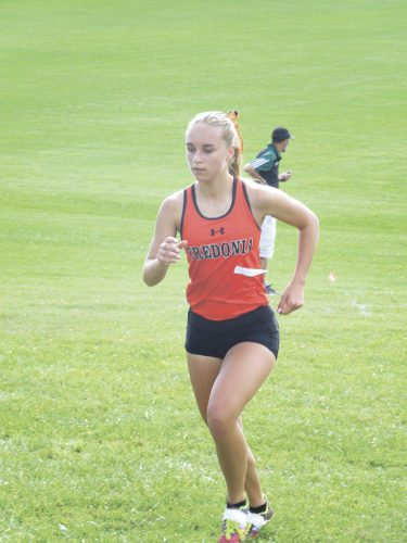 Submitted Photo Fredonia's Emily Brown running in Saturday's Pembroke Invitational.