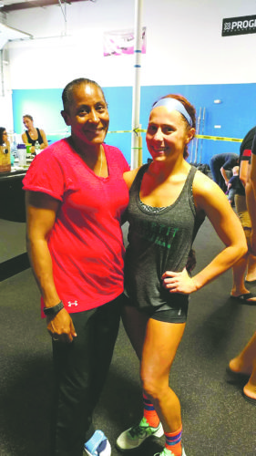 Submitted Photo Omayra Mendoza, left, and Allison Bevenue, right, represeted CrossFit Dunkirk at the QueenCity Throwdown this past Saturday.