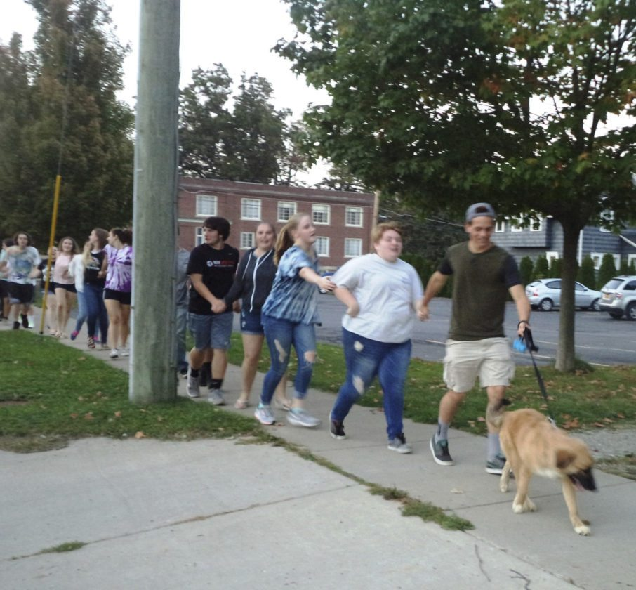 The snake dance winds its way through Moore Park led by senior class president Jimmy Wolfe and Hans.