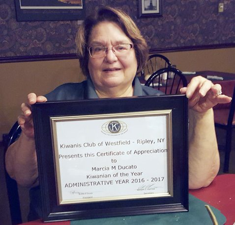 Maria Ducato is pictured holding her Kiwanian of the Year award.