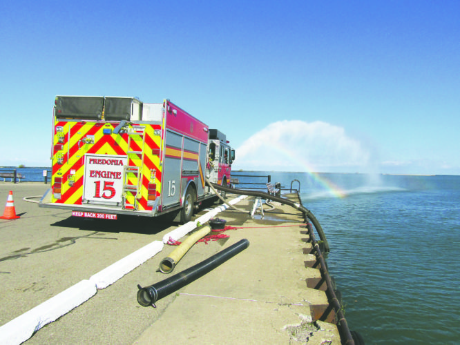 Photo by Gene Pauszek  There was no fishing action on the Dunkirk city pier late Tuesday morning, as Fredonia Fire Department trucks checked their water pressure valves.