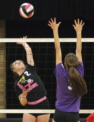 OBSERVER Photo by Lisa Monacelli Forestville's Caroline Kaicher (2) tries to hit through the block of Fredonia's Jenna Leid during a high school volleyball match Wednesday.