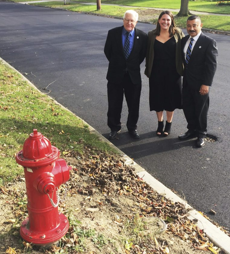 Submitted Photo From left, Director of Public Works Randy Woodbury, Director of Planning and Development Rebecca Yanus and Mayor Wilfred Rosas stand at Hoyt Street, which recently went under reconstruction.