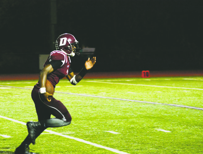 OBSERVER Photo by Justin Goetz: Dunkirk's Quantavis Kleckley heads for the end zone against Albion on Friday.