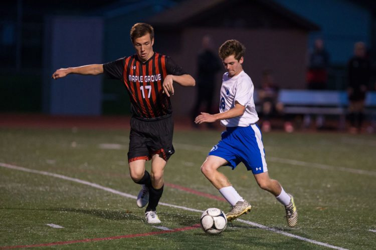 Photo by Tim Frank Westfield-Brocton's Jason Almeter advances the ball as Maple Grove's Wyatt Chriest defends during Monday's Section VI Class C boys soccer semifinal.