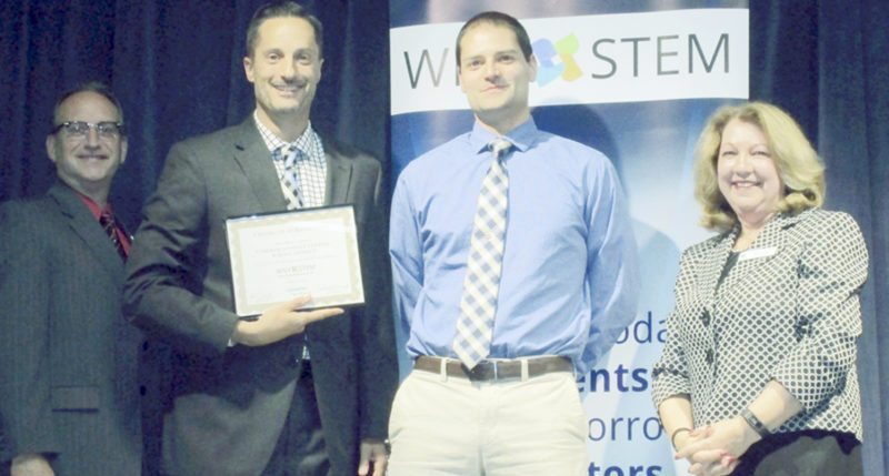 Submitted Photo Scot W. Stutzman (holding award) and James Mills (center) accept the recognition for Cassadaga Valley from Michelle Kavanaugh, WNY STEM Hub president and board member Mark Casell, Operations Manager for Siemens, Inc. (left).