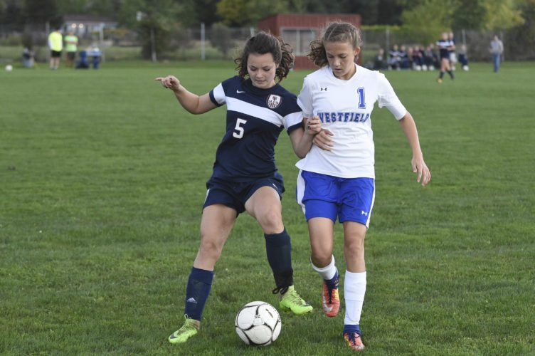 OBSERVER File Photo Westfield's Katie Bodenmiller, right, battles Chautauqua Lake's Hannah Gilmore (5) during a regular season match this past season. Bodenmiller was named to the First Team of the CCAA Central girls soccer all-star squad.