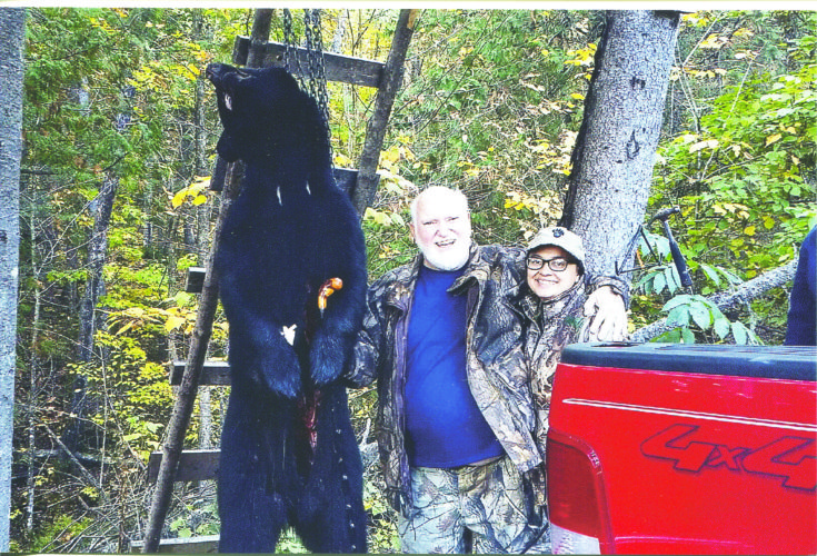 Bill Paige, standing with Melissa Tardi, tagged his 300-pound bear on Oct. 5 in the last minutes of the last day of his possibly final bear hunt.
