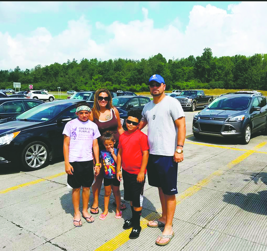 Submitted photo Joshua Cosme, right, is pictured with his family including his wife, Elizabeth, and their children, Aliana, Christopher and Anthony.