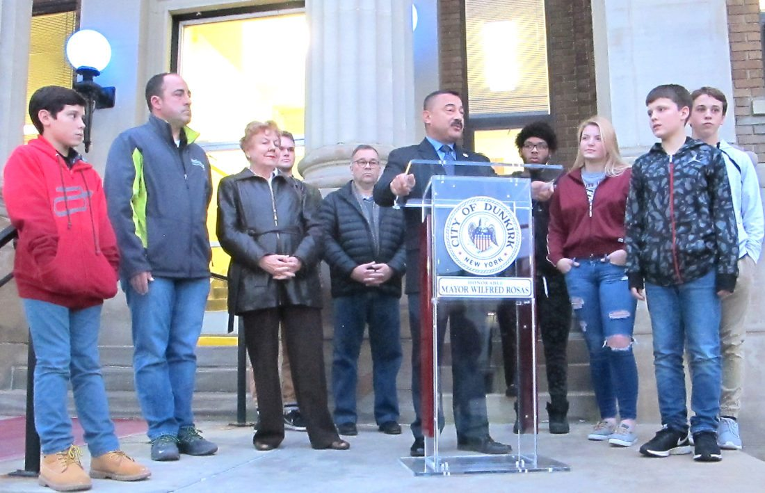 OBSERVER Photo by Damian Sebouhian Mayor Rosas addresses the crowd in front of City Hall regarding World Diabetes Day. With him stand members of the community who live with type one diabetes.