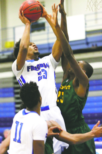 OBSERVER File Photo Fredonia's Ian Helps (23) goes up for a shot during a game from last season. Helps, the Blue Devils' leading scorer and rebounder as a junior in 2016-17, will be counted on to provide offensive punch.
